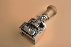 Vintage date stamp. Industrial office stamp. Old numbering machine on brown stock photos