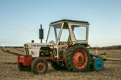 A vintage david brown white tractors with plough Royalty Free Stock Image