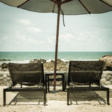 Vintage daybed and umbrella on the beach Royalty Free Stock Images