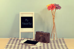 Vintage decor home on shelf. Vintage decor home on shelf  the old camera,vase flower,Polaroid,frame photo Royalty Free Stock Photo