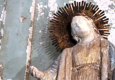 Vintage decorating at an Antiques store with a vintage crowned Santos Saint Religious figure statue Stock Photos