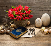 Vintage decoration with eggs and tulip flowers Stock Photo