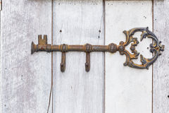 Vintage decoration key on wooden wall Stock Photo