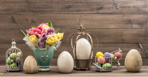 Vintage decoration with tulip flowers and easter eggs. Retro sty Stock Photography