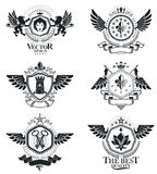 Vintage decorative emblems compositions, heraldic vectors. Class. Y high quality symbolic illustrations collection, vector set Royalty Free Stock Photography