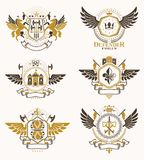 Vintage decorative heraldic  emblems composed with element. S like eagle wings, religious crosses, armory and medieval castles, animals. Collection of classy Royalty Free Stock Photography