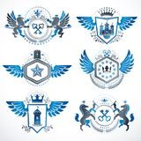 Vintage decorative heraldic vector emblems composed with element. S like eagle wings, religious crosses, armory and medieval castles, animals. Collection of Royalty Free Stock Image