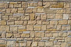 Vintage decorative stonework from cobblestones to the design,the texture of the stone. Vintage decorative stonework from cobblestones to the design,decorative royalty free stock photo