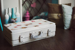Vintage decorative white suitcase Stock Photo