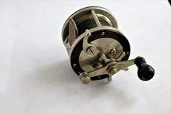 Vintage deep sea fishing reel. Vintage deep sea fishing reel with a star drag. leather thumb gaurd Stock Photo