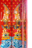 Vintage deity painting design on ancient wooden doors royalty free stock image