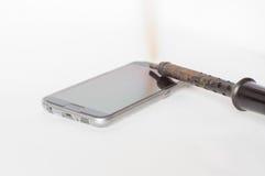 Vintage del soldador roto y del teléfono elegante Fotografía de archivo libre de regalías