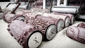 Vintage design artist tools: red textured rubber rollers royalty free stock photography
