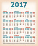 2017 Vintage Design Calendar. Illustration of a vintage design calendar for year 2017, with weeks beginning on monday and grunge textured background Stock Image