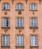 Vintage design windows on the facade of the old house. Vintage design windows on the facade of the old house Royalty Free Stock Images