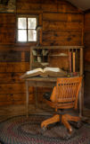 Vintage Desk with Ledger. Inside wooden cosy wooden building Royalty Free Stock Photos