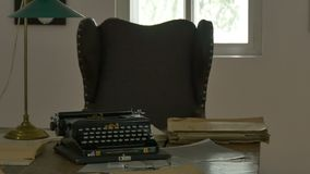 Vintage Desk and Typewriter. View of vintage desk and leather chair with lamp and typewriter in a room stock video