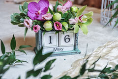 Vintage desktop calendar decorated with colored flowers. Wedding date decor Royalty Free Stock Image