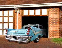 Vintage desoto car in garage. Photo of a blue vintage desoto car being driven into garage after a cruise around town Stock Photos