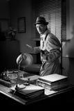 Vintage detective pointing a gun Stock Photo