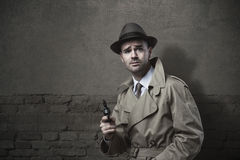 Vintage detective with revolver Royalty Free Stock Images