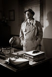Vintage detective standing in his office Stock Image