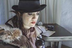 Vintage detective woman Stock Photo
