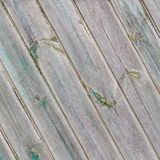 Vintage diagonal wooden boards with the remains of the green paint Stock Photo