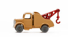 Vintage die-cast toy tow truck. Vintage die-cast tow truck with metal wheels and a red tow hook isolated on a white background Stock Photography