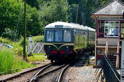 Vintage diesel electric railcar passes signal box of Tenterden heritage Railway England Stock Photos
