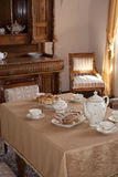 Vintage dining room. Festive table setting Royalty Free Stock Images