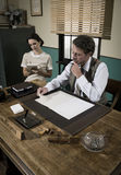 Vintage director and secretary working together at desk Stock Image