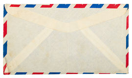 Vintage dirty airmail envelope. On white background Royalty Free Stock Image