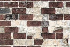 Vintage dirty brick wall. Background of old vintage dirty brick wall with peeling plaster Stock Photo