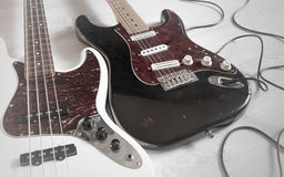 Vintage dirty worn electric guitar and bass Stock Photography