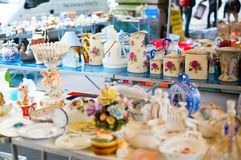 Vintage dishes on Parisian flea market Royalty Free Stock Photo