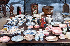 Flea market dishes. Vintage dishes for sale in a flea market royalty free stock image