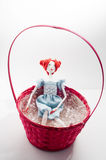 Vintage doll in a basket Stock Photo