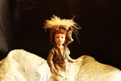 Vintage doll. In black background royalty free stock photo