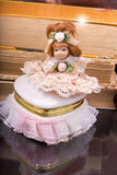 Vintage doll and ceramic box on the  old books Royalty Free Stock Photos
