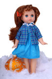 Vintage doll with christmas ball in snow Stock Images