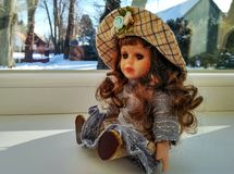 Vintage doll with curly hair stock photos