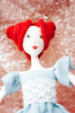 Vintage doll look. In plastic wrappings Stock Photography