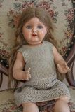 Vintage doll. My mom`s childhood toy from the 1930`s Royalty Free Stock Photo