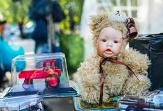 Vintage doll, in the suit of a teddy bear royalty free stock photography