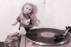 Vintage doll and turntable Royalty Free Stock Photo