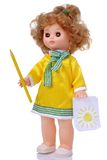 Vintage doll in yellow dress with pencil Stock Photos