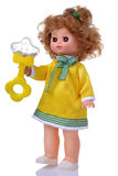 Vintage doll in yellow dress with rattle Royalty Free Stock Photo