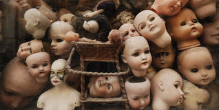 Vintage dolls heads. Uncommon image of disquieting vintage dolls heads, reminiscent of some classical horror themes, filling the photographic frame Royalty Free Stock Photos