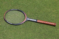 Vintage Donnay Borg Pro tennis racket on the grass tennis court. NEW YORK - JUNE 29, 2017: Vintage Donnay Borg Pro tennis racket on the grass tennis court Stock Photography